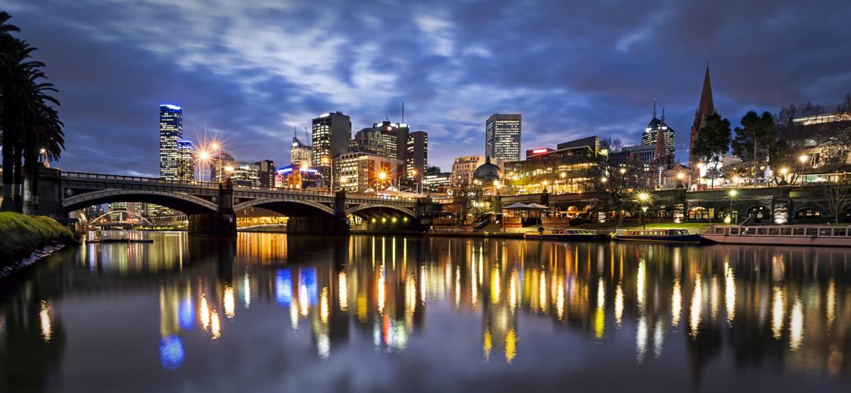 melbourne yarra river at night with buildings in background