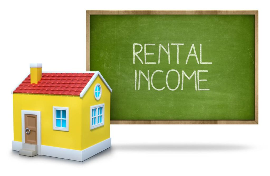 rental income on blackboard with house in front