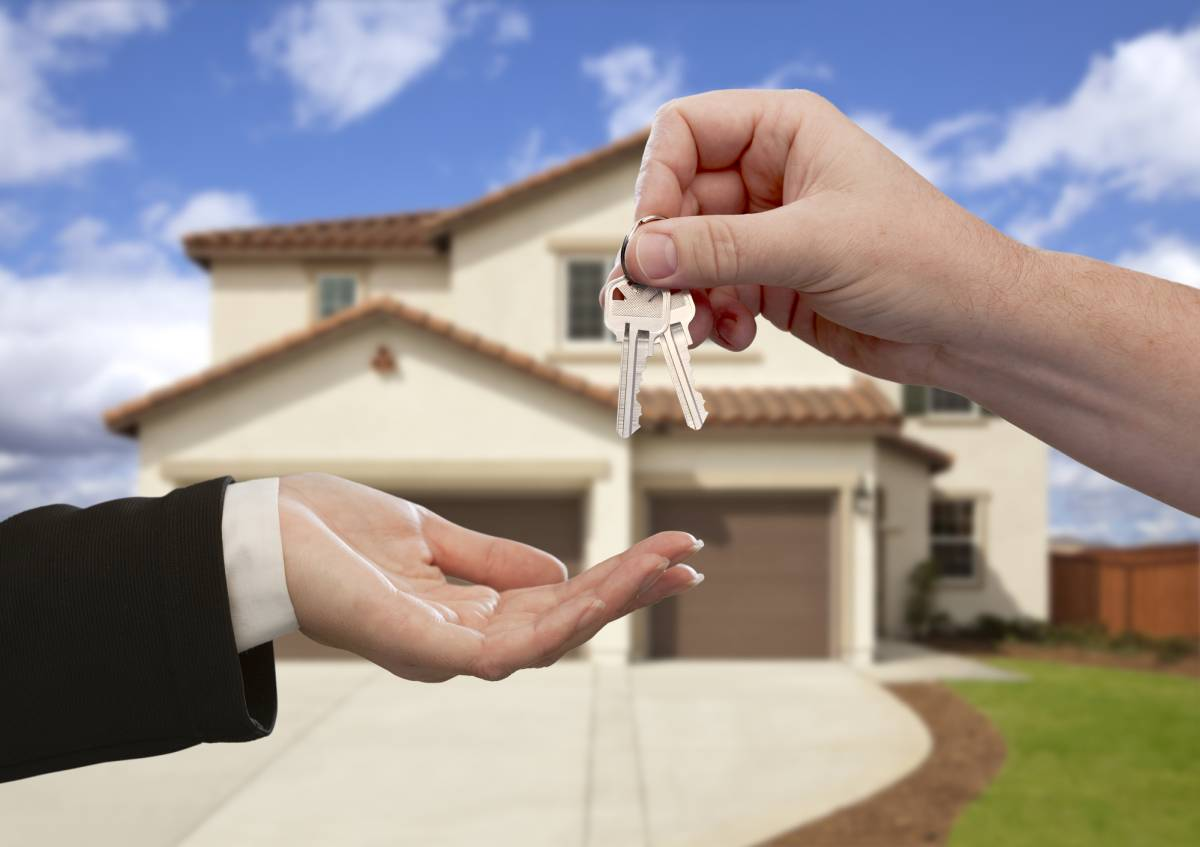 keys handed over in front of double storey home
